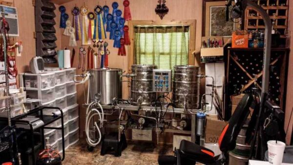 An image of a DIY brew room. Kegs and home brewing equipment in a home office like setting.