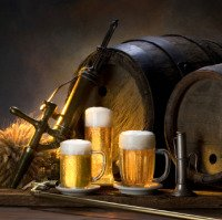 A picture of pints of beer in front of wooden barrel kegs.