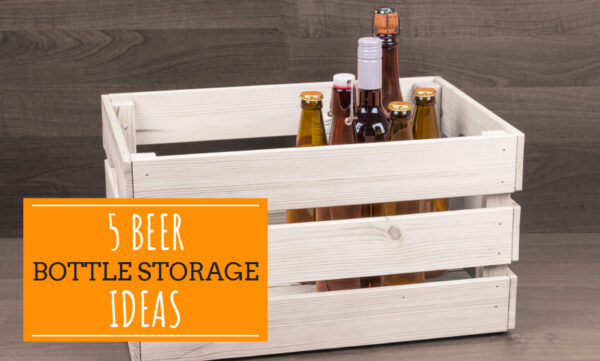 A picture of beer in a wooden crate. Text reads 5 beer bottle storage ideas.