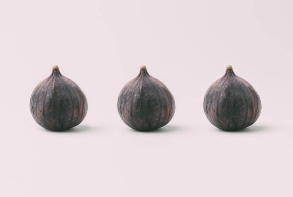 A picture of 3 figs with a white background.